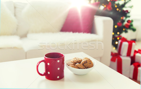close up of christmas cookies and red cup on table Stock photo © dolgachov