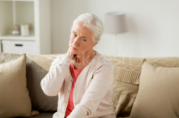 Starszy kobieta cierpienie ból szyi domu Zdjęcia stock © dolgachov