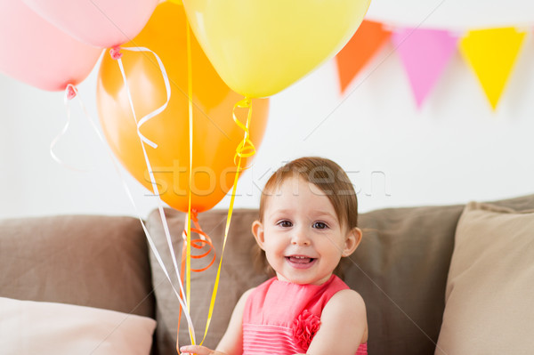 happy baby girl on birthday party at home Stock photo © dolgachov