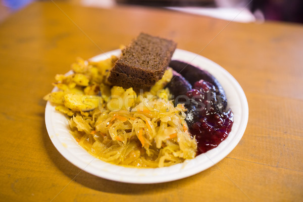 braised cabbage and sausages with sauce on plate Stock photo © dolgachov