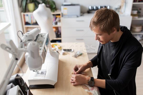 fashion designer with making dress at studio Stock photo © dolgachov