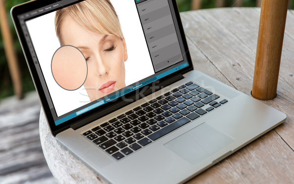 laptop with woman face retouch in graphics editor Stock photo © dolgachov