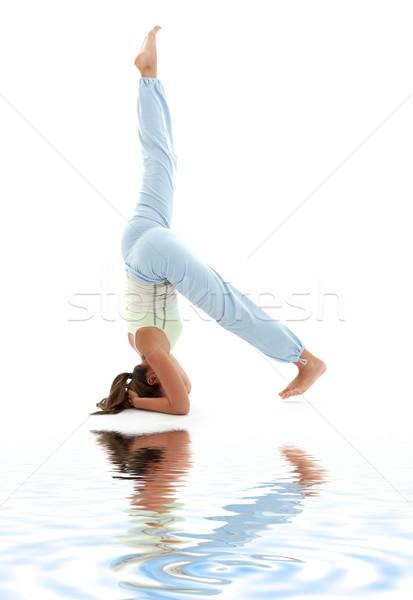 salamba sirsasana supported headstand on white sand #3 Stock photo © dolgachov