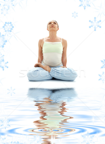 Stock photo: padmasana lotus pose on white sand