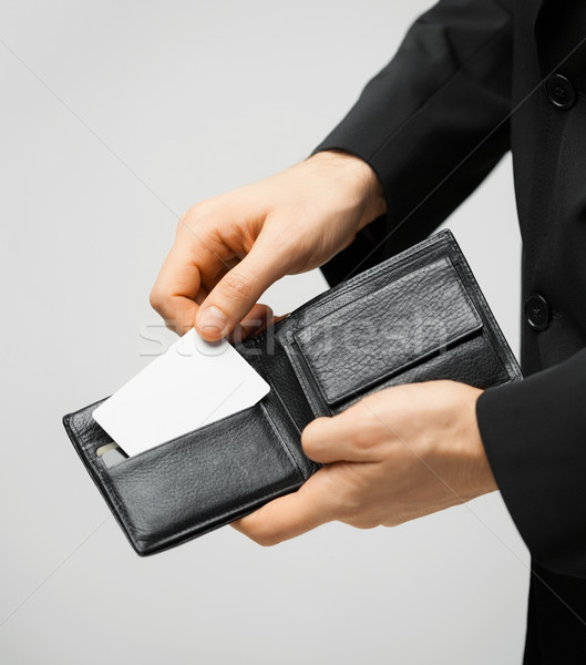 man in suit holding credit card Stock photo © dolgachov