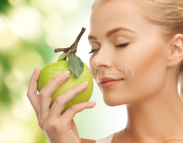 woman smelling apple Stock photo © dolgachov