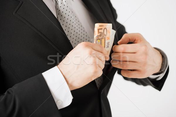 Uomo euro contanti soldi mano suit Foto d'archivio © dolgachov