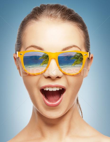 amazed girl in shades Stock photo © dolgachov