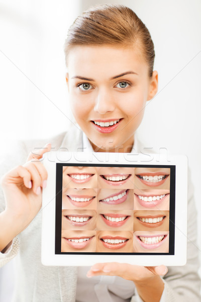female doctor with tablet pc and smiles Stock photo © dolgachov