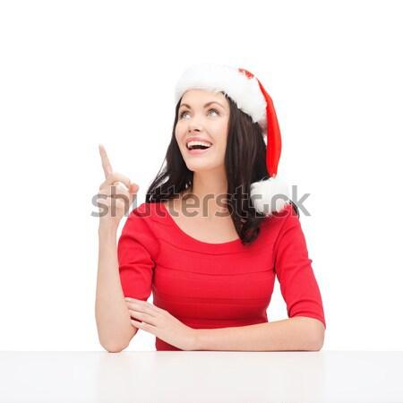 Nő mikulás segítő kalap mutat valami Stock fotó © dolgachov