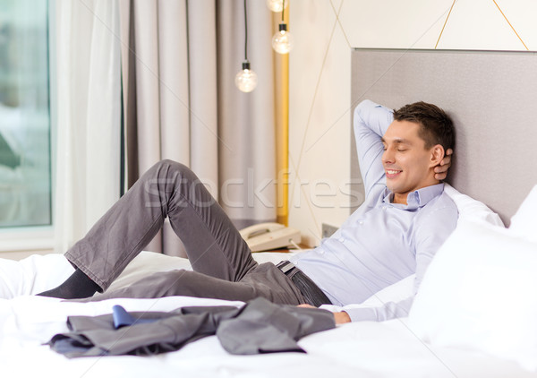 Feliz empresária cama quarto de hotel negócio tecnologia Foto stock © dolgachov