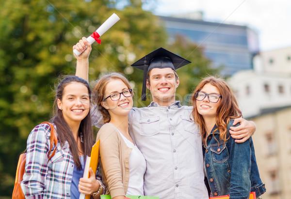 Stockfoto: Studenten · tieners · bestanden · diploma · onderwijs · campus