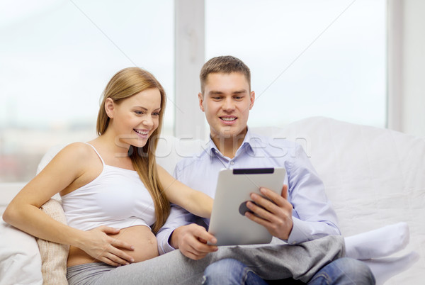 expecting family with tablet pc computer Stock photo © dolgachov