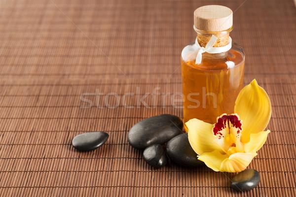 массаж камней орхидеи цветок Spa Сток-фото © dolgachov