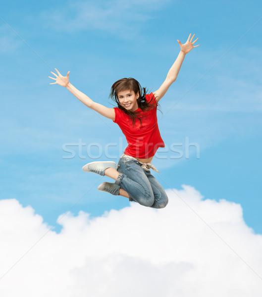 smiling girl jumping Stock photo © dolgachov