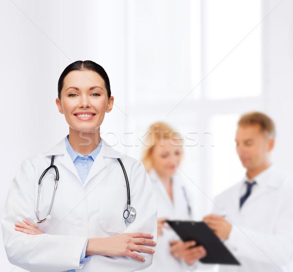 smiling female doctor with stethoscope Stock photo © dolgachov