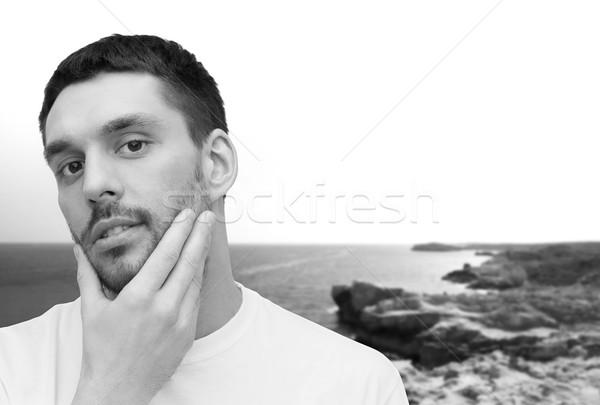 Belo homem tocante cara saúde Foto stock © dolgachov