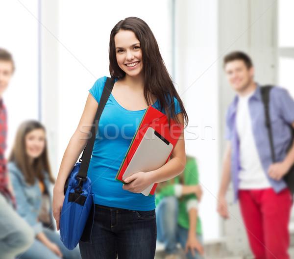 Glimlachend student zak mappen onderwijs Stockfoto © dolgachov