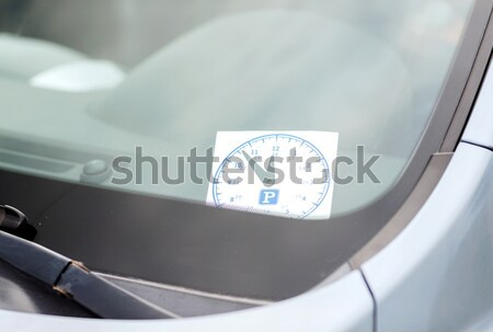 parking clock on car dashboard Stock photo © dolgachov