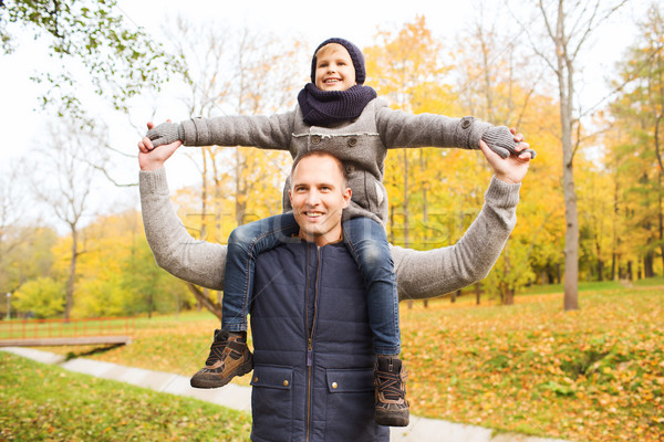 Stock photo: happy family having fun in autumn park