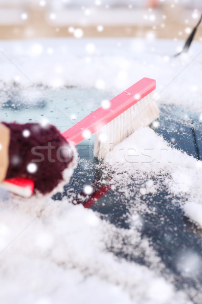 closeup of woman cleaning snow from car Stock photo © dolgachov