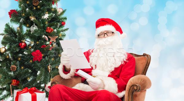 Homem traje papai noel carta natal férias Foto stock © dolgachov