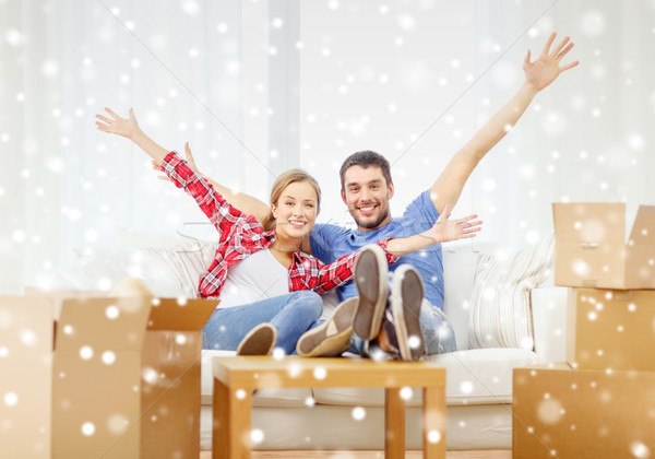 smiling couple relaxing and waving hand at home Stock photo © dolgachov