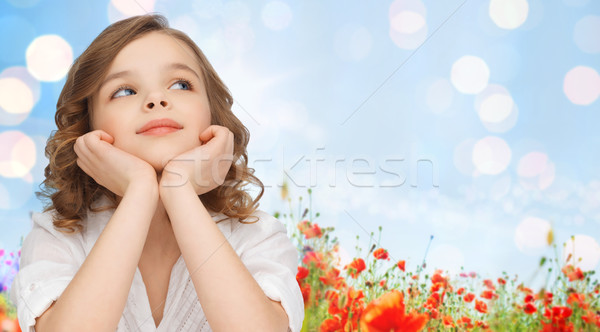 happy girl dreaming over poppy field background Stock photo © dolgachov