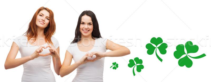 Mosolyog lányok mutat szív kézmozdulat shamrock Stock fotó © dolgachov