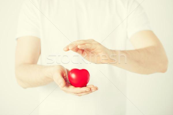 Homem mãos coração criança assinar Foto stock © dolgachov