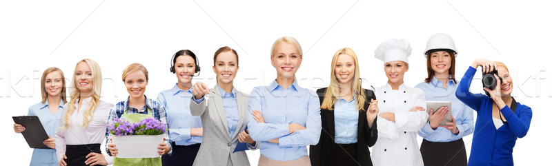 happy businesswoman over professional workers Stock photo © dolgachov