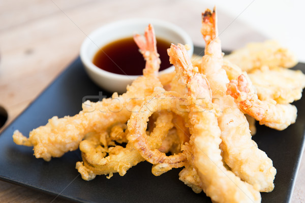 close up of deep-fried shrimps and soy sauce Stock photo © dolgachov