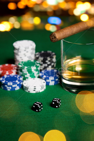 close up of chips, dice, whisky and cigar on table Stock photo © dolgachov