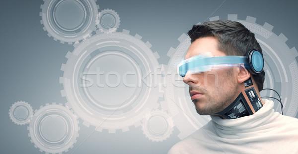 man with futuristic glasses and sensors Stock photo © dolgachov