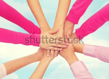 close up of women with hands on top over rainbow Stock photo © dolgachov