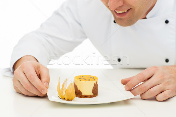 close up of happy male chef cook with dessert Stock photo © dolgachov