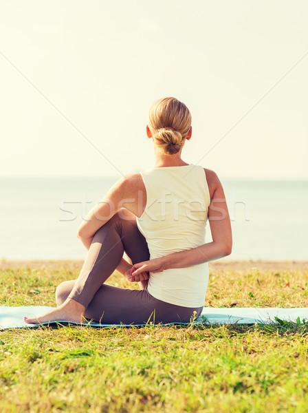 woman making yoga exercises outdoors Stock photo © dolgachov