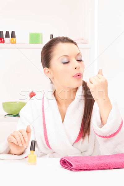 woman polishing her nails Stock photo © dolgachov