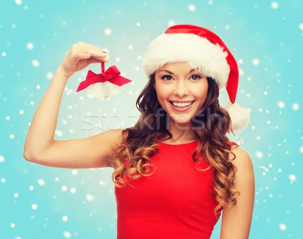 Kobieta Święty mikołaj pomocnik hat christmas Zdjęcia stock © dolgachov