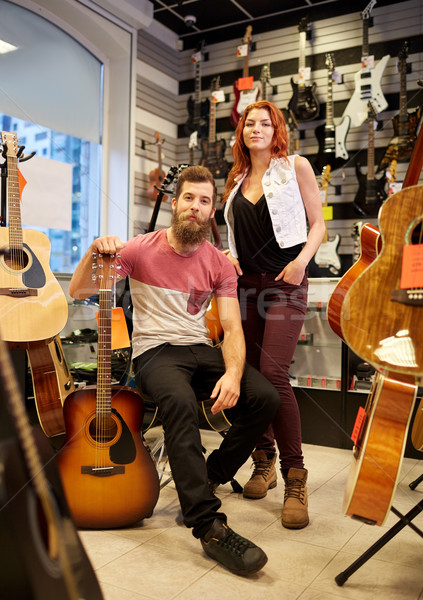 Stock photo: couple of musicians with guitar at music store