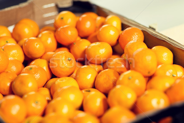 ripe mandarins at food market or farm Stock photo © dolgachov