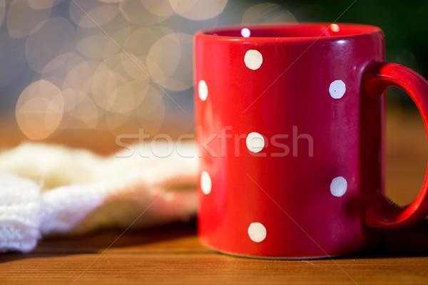 red polka dot tea cup on wooden table Stock photo © dolgachov