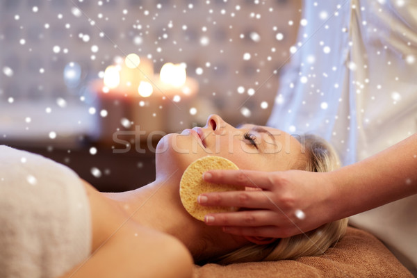 close up of woman having face massage in spa salon Stock photo © dolgachov