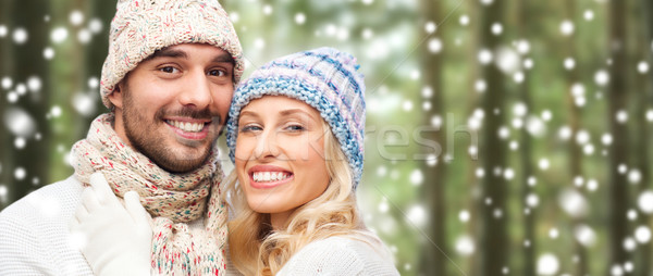 happy couple in winter wear over forest and snow Stock photo © dolgachov
