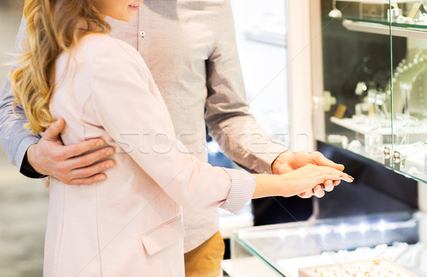 close up of couple choosing ring at jewelry store Stock photo © dolgachov