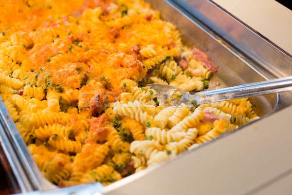 close up of pasta and spoon on catering tray Stock photo © dolgachov