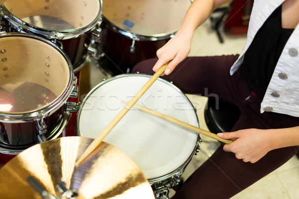Stock photo: close up of musician playing cymbals on drum kit