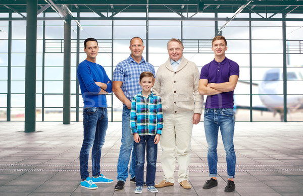 group of men and boy over airport terminal Stock photo © dolgachov