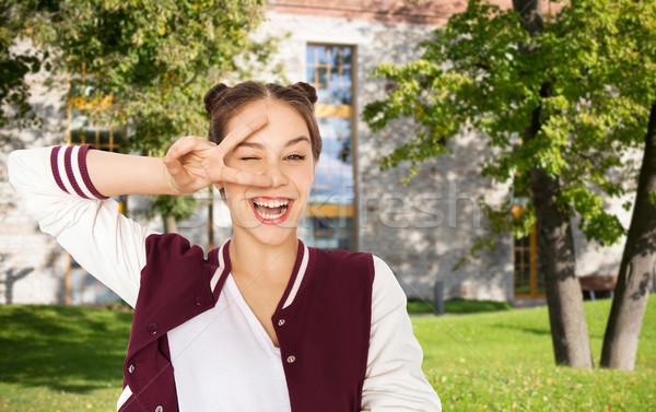 Felice sorridere pace segno Foto d'archivio © dolgachov
