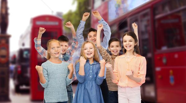 children celebrating victory over london city Stock photo © dolgachov